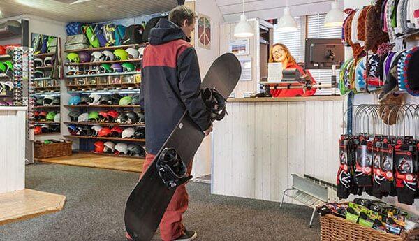 ski-higher-snowboarder-in-shop
